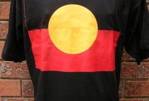 Aboriginal Flag T-Shirts / T-Shirt is made from 100% cotton and either black or white in colour. The detailed design was professionally silk screen-printed and will not wash out - these are high quality t-shirts that will last for years! (this is a fully licensed product and royalties are paid to the artist - Harold Thomas)