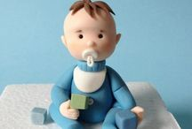 baby in blue with soother
