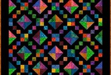 Four Patch Based Quilts