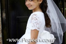 First Communion Dresses / Beautiful First Communion and Cotillion Dresses by Pegeen.  See various styles and fabrics, Communion white silk, white satin, white tulle and and white organza dresses. Gorgeous laces and beading. Modest cotillion dresses with style and grace for that special day.  Pegeen.com is a manufacturer of flower girl dresses & boys suits - Infants to Plus Size. 200+ colors in Silk. Headquartered in Orlando FL .. 1 mile from Disney!! 407.928.2377