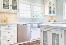 Hampton Design: White and blue kitchen design with white kitchen cabinets paired with marble countertops ...