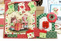 Helz Cuppleditch Dear Santa / Join the Christmas festivities with Helz Cuppleditch's Dear Santa papercraft collection. This nostalgic selection of designs captures the magic of Christmas through a childs' eyes. To complement the illustrative and decorative papers, the collection also has a coordinating decoupage pad, garland flags, character toppers, stamps, blossoms, gems, buttons and wooden shapes to complete each festive design!