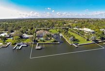 SOLD: 14898 Palmwood Road / 14898 Palmwood Road is a prominent waterfront estate offering over 2 acres of direct Intracoastal Waterway property and over 300' of frontage. Private yacht basin on property will accommodate a 100'+ motor yacht in addition to secondary dock. The sprawling estate property offers two vacant land parcels which could be built upon or kept as serene private grounds (4 total parcels included in this property).