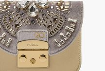 Furla 90th Anniversary / Furla introduces the 90th Anniversary collection travelling across nine decades: ninety years of history reflected in a handbag and in its flaps.