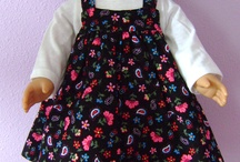 Dolls and doll clothes.  / by Sandy Shields