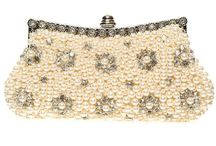 Evening Clutches and Handbags / The Bella Krystal Evening Clutches & Handbags Collection offers stunning arm candy for you to carry at special occasions. Beautifully crafted and embellished with the finest quality pearl beads and Swarovski® crystals, these clutches and handbags complement your fancy gown, high heels and jewellery to complete your glamorous look. Be it the bride or the mother of bride or the matron of honour, we have magnificent handbag options for all.
