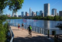 The Boardwalk Trail Bridge scenic skyline view over Lady Bird Lake - Stock Photo Image Gallery / The Boardwalk Trail at Lady Bird Lake provides a safe, continuous ADA compliant pedestrian and bicycle access along Lady Bird Lake and parkland. Visitors and citizens of all levels of ability are able to access the town's lake and have a safe transportation alternative to riding in a car. Completing this section of lakefront trail has also linked communities on the city's east side to the downtown area as well as to the westside.