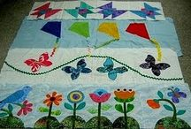 Row Quilt Inspiration / Assemble rows of traditional or pictorial blocks and sew them together to make a Row By Row Quilt.  Row Quilts are often themed, and I'm exploring ideas to create one.