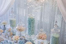 Light Blue + Chandelier Lolly Buffet / A glistening silver sequin backdrop framed this elegant sweets table perfectly. Complimented by cascading draping and  a crystal drop chandelier to illuminate and accent the array of perfectly packaged sweets, custom designed chocolate bars, and colour matching candy.  Extravagantly detailed, this lolly buffet was a truly memorable gift for guests to remember. Youtube: https://www.youtube.com/watch?v=mrhEmG37IWQ