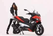 Aprilia SR Max / SR Max is the new Aprilia scooter which brings the Piaggio Group racing brand into the grand touring segment. Available in the 125 cc or 300 cc version, SR Max puts the Aprilia sport spirit on the road for pure enjoyment and riding pleasure. / by Aprilia Official