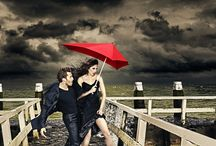 Senz Umbrellas / senz male and female in stormy weather