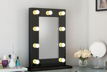 High Gloss Hollywood Mirrors / The ultimate in make-up mirrors. Professional quality, stylish mirrors available from only £179.99.  LED golf-ball bulbs used for maximum efficiency, with a dimmer with on the right hand side to control the balance of the lighting.