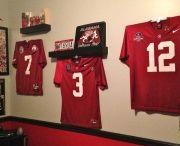 Alabama Crimson Tide / Alabama jerseys displayed using the affordable Ultra Mount jersey display hanger.  A great affordable alternative to jersey frames.