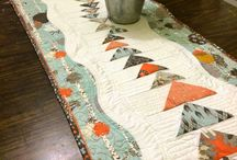 Table runners / Small quilts add big impact to your home decor!  I love that you can change them out for seasons and enjoy a fresh new look on your table.