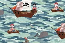 Pirates from Makower and Henley Studios / Ahaaa! 'tis true me hearties. Makower have landed their secret treasure map and pirate fabric at Juberry Fabrics in Newbury.  Avast you landlubbers, there be a scallywag that needs a pirate quilt.  We've made it easy for 'e by providing the pirates treasure you need in a kit.  Yo, ho, ho and ye won't need to part with all of your pieces of eight. Savvy.  So weigh anchor and hoist the mizzen to Juberry for your booty. Aaargh.