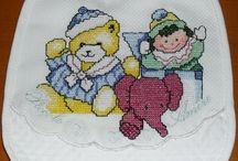 Bavaglini a punto croce -  Cross stitch bibs
