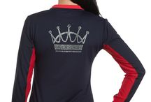 """Charlotte Studio Krystal Collection Shirts / Our signature Charlotte shirt with a beautiful twist! In Denmark, women are not shy to show their fun side which is an inspiration for our """"krystal"""" embellished UV Protective shirts. Whether you are sporting our Kastel Denmark crown or showing your patriotic side as Charlotte does through her dual citizenship, you are sure to impress while you remain cool and sun-protected."""