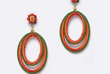 Compl. de flamenca naranja / Pendientes, peinas, collares y pulseras flamenca en tonos naranja disponibles en nuestra tienda online.