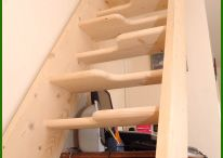 Space Saver Staircase / This space-saver staircase is a quick and economical means to gain access to a loft, giving the client an extra bedroom or valuable storage space.   The treads are made of yellow pine.