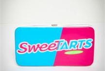 Sweetarts For My Sister  :-) / Sweetarts (officially stylized as SweeTARTS) are sweet and sour candies invented by J. Fish Smith, the owner of Sunline. The tablets were created using the same basic recipe as the already popular Pixy Stix and Lik-M-Aid products, in response to parents' requests for a less-messy candy.  This board is dedicated to my sister, Sandy who has eaten Sweetarts since young enough to eat them  and still to this day eats them. I was blessed with a special sister who I love so very much.