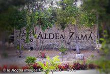 Aldea Zamá - Tulum / Aldea Zamá - Tulum Zona comercial, Nocturno.