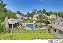 Homes For Sale Central LA at Darren James Real Estate Experts / This luxurious one-of-a-kind New Orleans style Country Estate blends authentic Southern architectural balance and a park-like setting, taking you back to the fabulous grand homes of the Old South. Meticulously constructed with Old Chicago brick, slate roof and patios, wrought iron enhancements, over-sized front porch with columns and a gracious Southern style front entry.