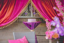 Marrakesh 60th Birthday / Drawing inspiration from the bright and vibrant textures of Marrakesh, this 60th Celebration captured the flair and colourful accents of Morocco. With varying hues of purples, plums & magenta, complimented by brass vases filled with tropical flowers. Moroccan Lanterns & tealight votives illuminated the space, creating an intimate and exotic atmosphere.  Enchanted Empire