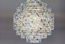 Phebo 2010 - Numbered edition / A mosaic of pendants is shaped into geometric proportions that defy the visual perception of their forms. A sphere might appear, unveiled by a layering of staggered cylinders, where the refraction of the crystals is renewed with each tier. In the meanwhile, light pulsates in the center and vibrates its way through each of the three thousand gems.