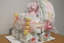 Diaper cakes / by Amy {fun-baby-shower-ideas.com}