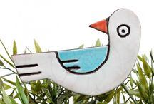 Garden & yard art / Our garden and yard art animals and flowers are each handmade and hand painted, using our signature clay and paint tones. Mounted on a stainless steel rod, they can be placed in plant pots or flower beds, inside or out.