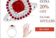 CUSHION RUBY AND DIAMOND DOUBLE HALO RING