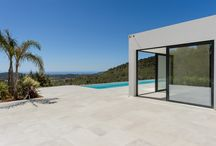 New built villa with 180º views in Morna Valley, northeast of Ibiza / Modern new built villa situated on a hill in the emblematic area of Morna Valley with 180 degrees unspoiled views over the countryside all the way to the sea. The property is situated on a 25 hectars large private plot. Large living and dining rooms. 7 bedrooms and 7 bathrooms. Various terraces and pergolas surround a large lap pool. Mediterranean garden. On the very top of the hill an old stone house with fantastic views is waiting to be upgraded. View property: http://bit.ly/1ODhw8h