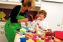 Kids In The Kitchen / Your mini-chefs want to be just like you and love helping out in the kitchen.  These little guys especially love our bright, colorful utensils and gadgets.  Show us what you're cookin'!