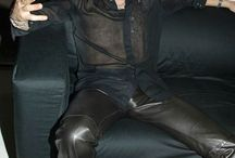 Celebrity in leather pants
