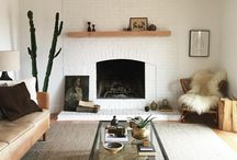 Our Lounge / White, Light Blues, Browns, Greens, Burnt Orange's.  Clean, Warm, Minimalist, Wood, Plants, Cozy, Small, Homely.