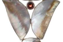 Marta Howell / Handmade silver jewelry from renowned jewelry artists Marta and David Howell featuring exotic shells and minerals, semi-precious stones, opals and fossils.