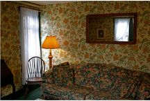 "Room Four - The Old Village Inn / Room four is located on the second level of our establishment and is considered a ""two-room"" suite.   Bedroom w/Queen Bed Living Room Small Balcony"