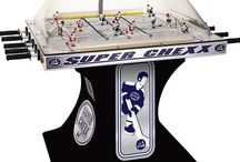 Chexx Hockey arcade game  / Chexx Hockey has been #1 in dome hockey gaming since 1980. If you have never played before, Chexx Hockey is like foosball on steroids! Enjoy head-to-head puck-slapping action along with authentic sound effects from the crowd's cheers and jeers, full game-play commentary, and classic organ tunes. Plus all the scoring is done electronically via the digital scoreboard.