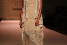 #OffTheRunway: Kavita Bhartia AIFW S/S '16 / Quite and Chaos - Kavita revisits tradition & interprets it in a modern way gives a new take to Ikat. She combines it with a intense use of geometrics, architecture & paisley with contemporary silhouettes.Paneled skirts, voluminous circular skirts, dresses, crop tops, pleated pants & jackets make their way into the collection. Floating elegant dresses are building in popularity this season giving a romantic look. Shop Now on: http://bit.ly/1hvGOXh