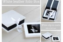Folio boxes and Slip-in matts / Folio boxes are available in denim, leather, linen, plain black, custom printed design of your choice, Swe Swe, black beluga…..let us know which one you love the most. Matt board used for the slip-in is available in black, white, cream and navy. You can even custom print our ribbon.