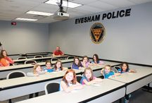 Station Tour-Girl scout troup  May 8, 2014 / On May 8th, 2014, a girl scout troup was given a tour of the police station.  They were also given safety information by Ofc. Mike Trampe.