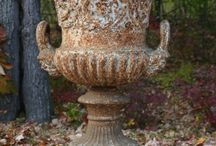 Feature urns or potted plants
