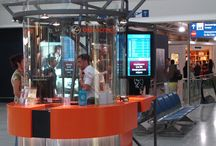 Athens International Airport / Eurochange S.A. operates currency exchange booths throughout the Athens International Airport. Panel TV, a Greek Digital Signage Expert, proposed and installed ONELAN solution to perfectly meet today' customer requirements, and comply with centralized future administration objectives.