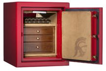 USC Collection / As an enthusiastic alumna of the University of Southern California, Casoro Jewelry Safes co-owner Nancy Bryan had the team create something special for her alma mater and fellow alums. This safe provides industry-leading burglar and fire protection in striking SC cardinal and gold. USC logos adorn both the exterior and interior of the safe. Inside are elegant microsuede lined drawers for your fine jewelry and watches.