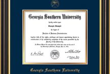 Georgia Southern University Diploma frames & Graduation Gifts / Official GS Diploma frames. Exquisitely crafted to exacting specifications for the GS diploma. Custom framed using hardwood mouldings and all archival materials, including UV glass to prevent fading from sunlight AND indoor incandescent lighting! Each frame exceeds Library of Congress standards for document preservation and includes a 100% lifetime guarantee, ensuring that a hard-earned achievement will be honored and protected for generations. Makes a thoughtful and unique graduation gift!