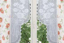 Schema su carta a quadretti per realizzare coppia tende uncinetto filet con motivo fiori