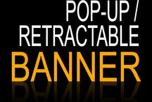 "Retractable / Pop-Up Banners / 33"" x 79"" Retractable Banners w/ Stands. Portable and PERFECT for your trade shows!"