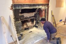 Inside fire place renovation / This is a reconstruction of an existing fireplace and changing the look with a taller fire box with a herringbone brick finish and a lime stone surround