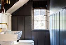 Dark painted panelling in shower room