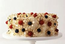 decorate your cake with sliced sliver almonds and berries to make flowers